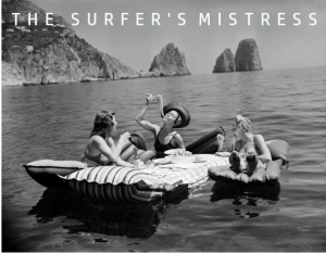 three ladies in a boat on a lake eating pasta. The words 'The Surfer's Mistress' are above.